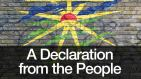 A Declaration from the People. A graffiti-style wall mural with the title and a sunburst on a brick wall