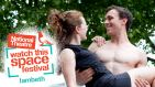 National Theatre Watch This Space Festival Lambeth. Bare-chested man carrying woman in a dress, beneath a canopy of trees