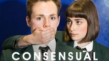 National Youth Theatre: Consensual.  2 teenagers in school uniform, one with her hand over the boys mouth