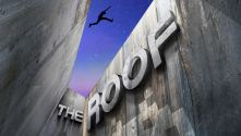 The Roof - title treatment on concrete chasm looking up with free-runner leaping across the void