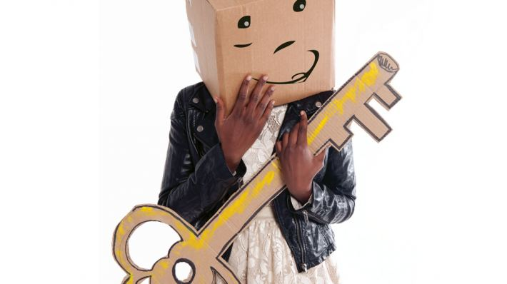 The Guffin figure with carboard box head and giant cardboard cut-out key