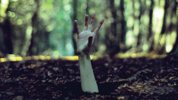 Antigone: a hand reaching up from out of the earth