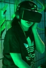 enter wonderland person wearing Oculus Rift headset
