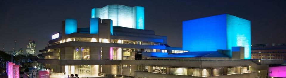 National Theatre with flytowers lit up at night
